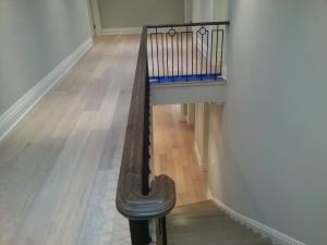 Custom railing, metal spindles, hardwood floor installation