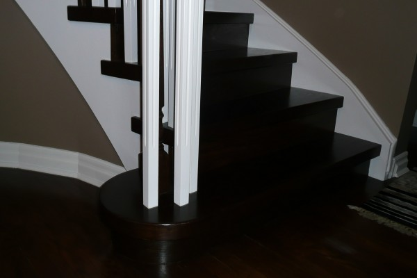 Install steps, dark stain, and white spindles