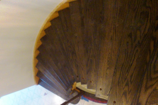 Install cap system stairs, staining, and finish