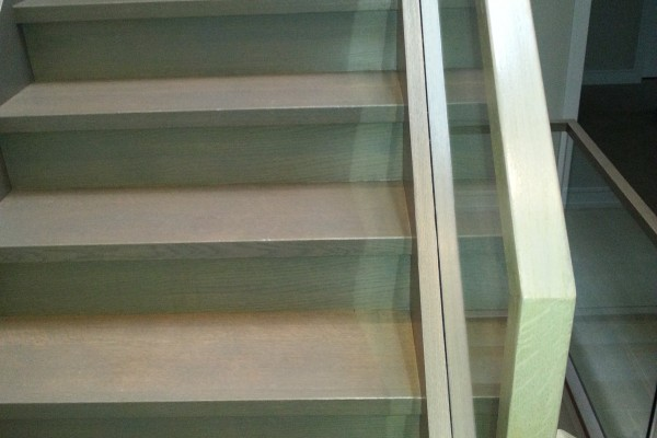 Gray stairs installation with glass railing