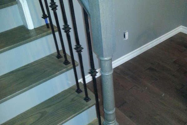 Staircase with metal spindles, steps installation, staining